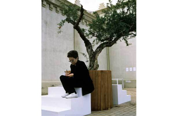 "Installation Photograph of Yoko Ono with ""Wish Tree,"" 1996,in the exhibition "" En Trance "" at the Lonja del Pescado, Alicante,June 1997. Photograph by Miguel Angel Valero."