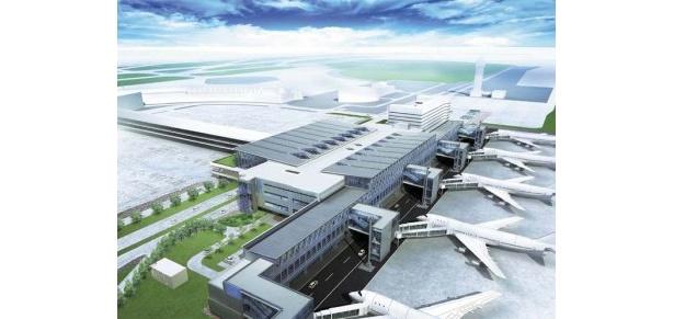 現在のターミナルビルの、駐車場をはさんだ向かい側に建つ、地上4階建ての新千歳空港新国際線旅客ターミナルビルの完成予想図