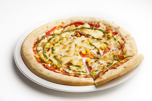 「ピッツァ・マルゲリータ」(ホール・1000円)。トマトとチーズ、バジルが絶妙なコンビネーションの一品。