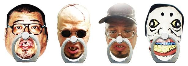 【写真を見る】くっきースマホリング(各1500円)。左から「バランスおじさんバージョン」「ゴモラ人間バージョン」「一般人バージョン」「やなぎ浩二バージョン」