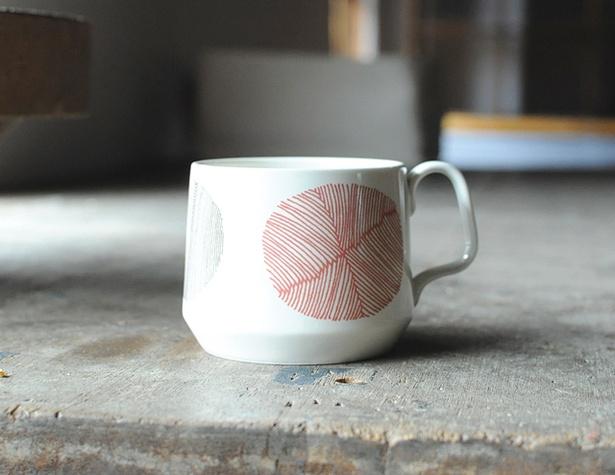 「sabato」の「mug ソーレ」(3024円) 。Sabatoイラストは太陽がモチーフ。温かみのある色と形が特徴