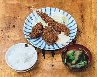 エビ、カニ、ヒレカツが楽しめるA定食は1450円(味噌汁、ご飯付き)。市場関係者にはカレーやハンバーグも人気とか
