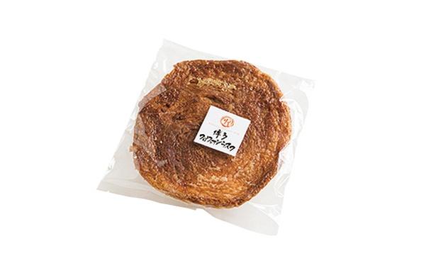 「手作りパン工房 フレ」の「博多クロワッサンラスク」(1枚258円)。生地に仏産のカソナード(赤砂糖)を巻き込み、キャラメル状に焼き上げる