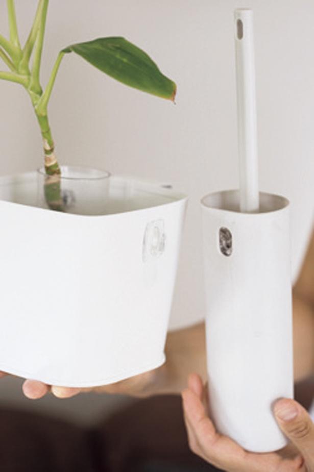さらに掃除用モップを鉢カバーにつるせば、目隠し効果も!