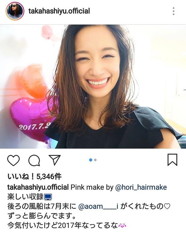 すてきな笑顔を見せる高橋ユウ