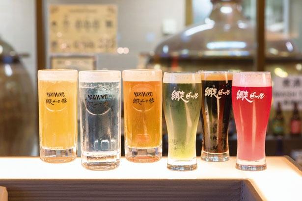 左から、ABASHIRIホワイトエール、流氷ドラフト(各540円)、網走プレミアムビール、知床ドラフト、監極の黒、桜桃の雫(各626円)。飲み比べ4点セット(864円)もある