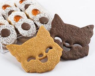 奥から「アトリエ ロンド」の「ロンドの足跡」(1,404円)。手前は、「ネコのクッキー」(各150円)。左がナチュール、右がショコラ