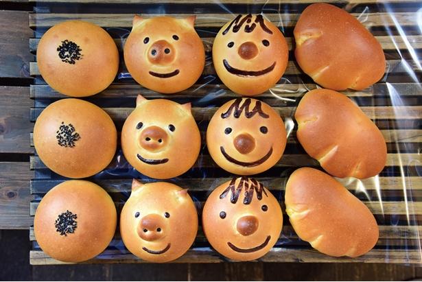【写真を見る】みやげに喜ばれそうなキュートな顔型パン / シゲパン