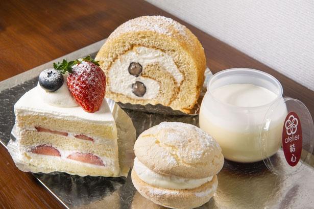 素材を生かして丁寧に仕上げられたお菓子が並ぶ。「苺のショートケーキ」(520円)、「ふんわりブッセ」(200円)、「丹波の黒豆ときな粉のロールケーキ」(450円)、「ゆっこぷりん」(300円)