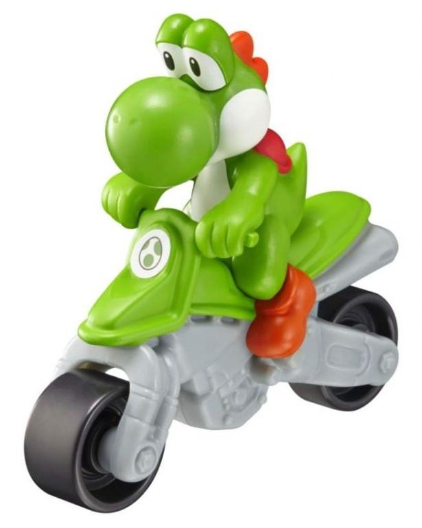 ヨッシーのフィギュアが乗ったバイク形のおもちゃ