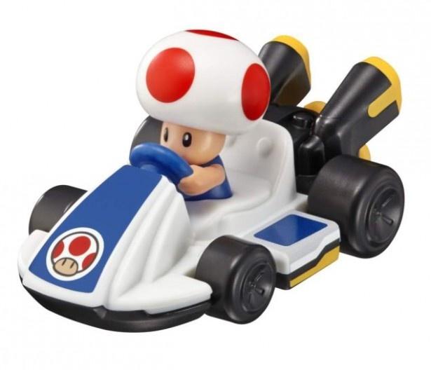 キノピオのフィギュアが乗ったカート形のおもちゃ