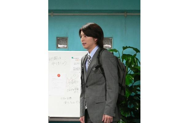 """主人公""""マ男""""が会社に戻ってくるシーンのテスト風景"""