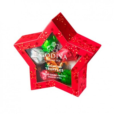 真っ赤な星形パッケージの「ラッピングチョコレート クリスマス スターボックス」(9粒入1620円) 。限定ラッピングのトリュフ ミルク・ダーク、定番のトリュフ ホワイトの詰め合わせ
