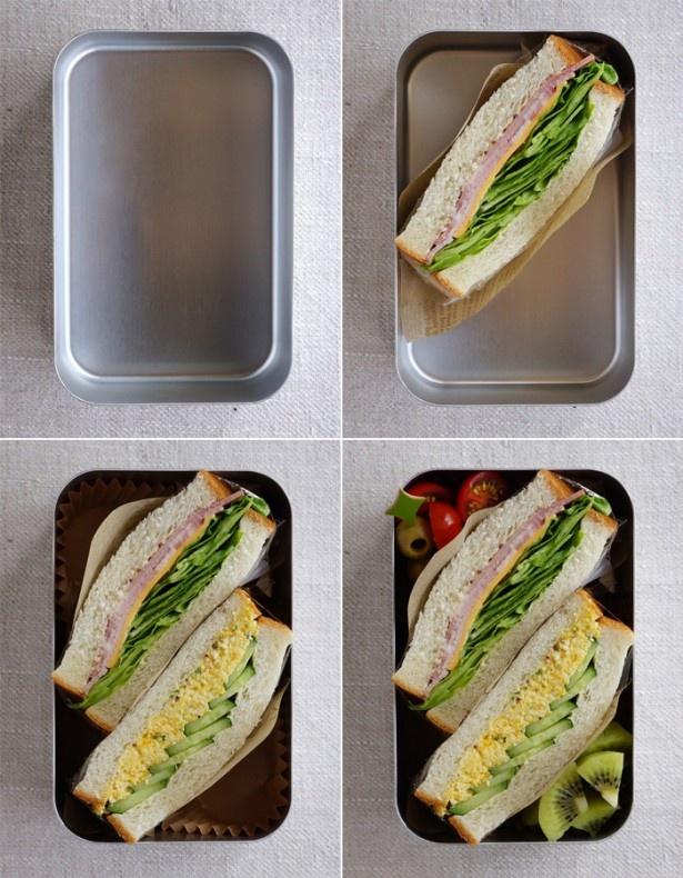 サンドイッチの高さに合わせたお弁当箱(左上)切ったサンドイッチを詰める(右上)二つの切り口を平行に、高さも合わせる(左下)サブのおかずを詰め全体を整える(右下)