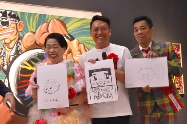 イベントで高校生以来の絵を描いた今くるよと、COWCOWの善し、伊勢丹チェックのスーツ姿のCOWCOWの多田健二