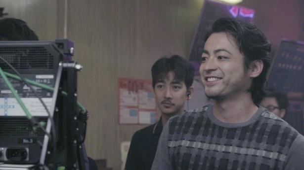 満足の出来栄えに思わず笑みがこぼれる山田