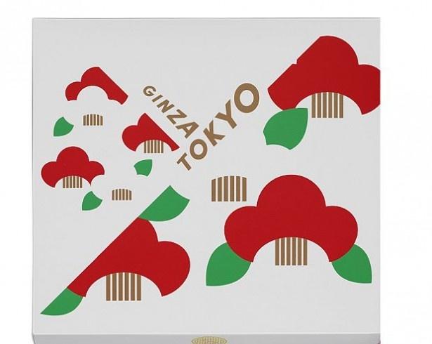 【写真を見る】赤と白の椿を描いたパッケージデザイン